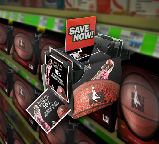 Image of a coupon dispenser attached to the side of a shelf containing Double Dunk basketballs. The dispenser has a picture of basketball player Darrell Yell on it and the words, 'Be your best.' Sticking out of the dispenser is a coupon advertising 10% off the price of a Double Dunk basketball.