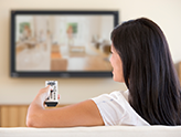 Photo of woman watching TV