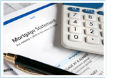 Picture of a mortgage statement, a small calculator, and a pen.
