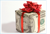 money in the shape of a present with a bow