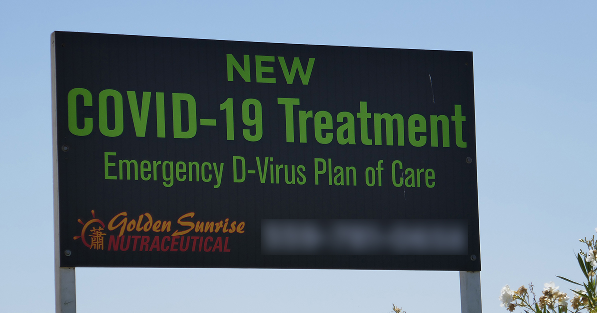 "Billaboard display stating "" NEW COVID-19 Treatment Emergency D-Virus Plan of Care, Golden Sunrise Nutraceutical"""