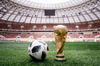 World cup trophy and a soccer ball