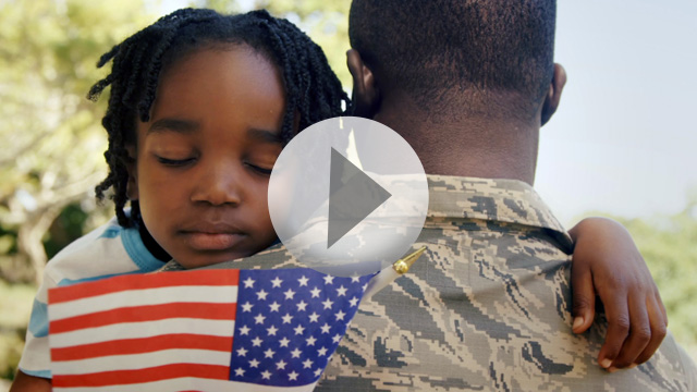 Military Veteran Hugging Child