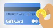 hand holding coin scratching off the personal identification number for a gift card